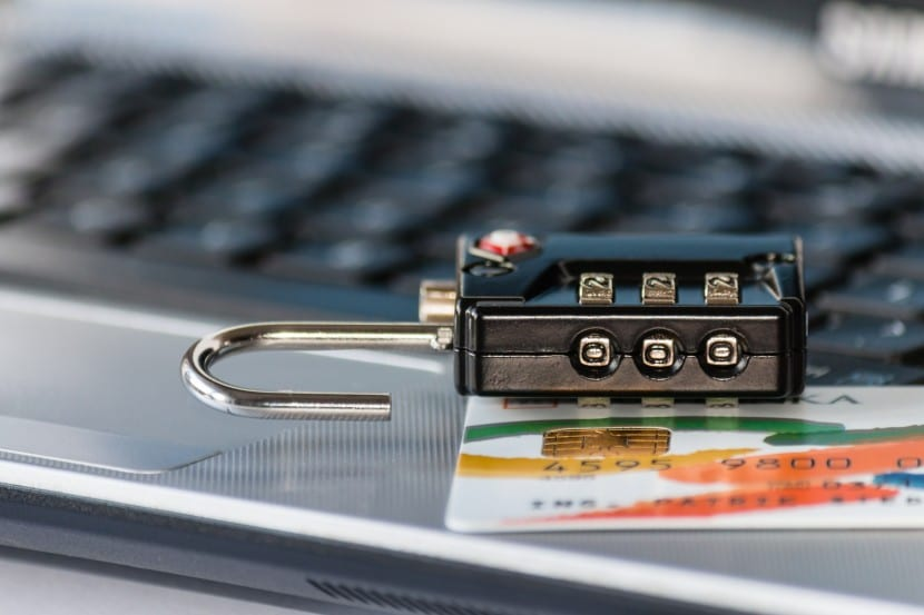 combination lock with credit card on laptop